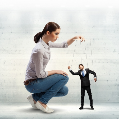 Image of pretty businesswoman puppeteer  Leadership concept Stock Photo