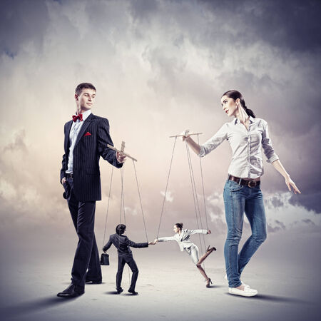 Image of man and woman with marionette puppets 版權商用圖片