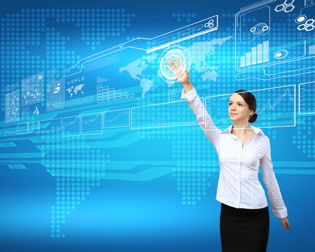 BusinesswomBusinesswoman standing and working wth touch screen technologyan and touch screen technology photo