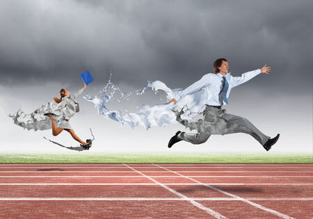 Funny image of young businesspeople running at stadium photo