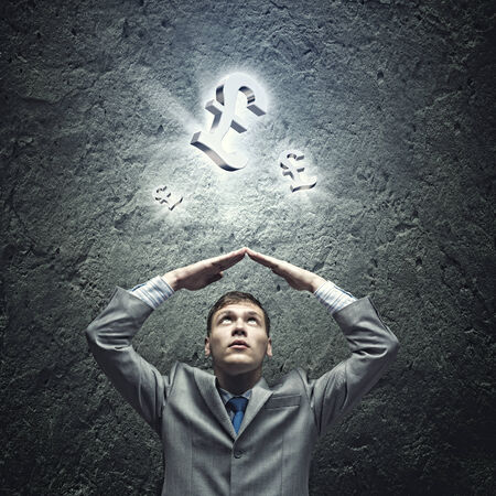 arms above head: Young businessman Holding arms above head  Money concept