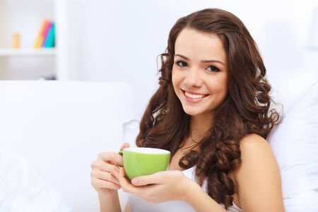 Portrait of lovely young woman having cup of tea at home Stock Photo - 25644060