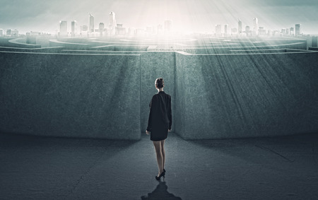 Businesswoman standing near the enter of labyrinth