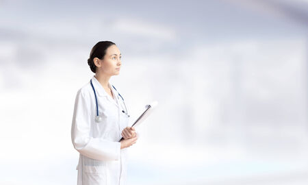 Young attractive woman doctor with stethoscope on neck Stock Photo - 25644204