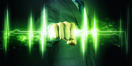 Businessman holding lightning in fist  Power and control photo