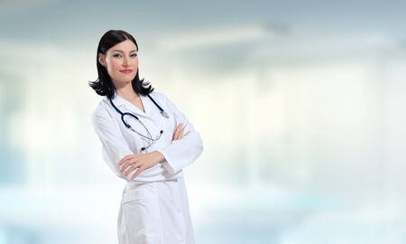 Young attractive woman doctor with stethoscope on neck photo