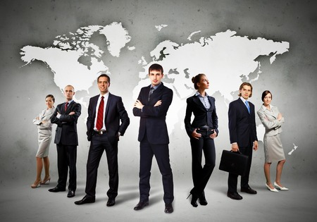 Image of businesspeople standing against world map background photo