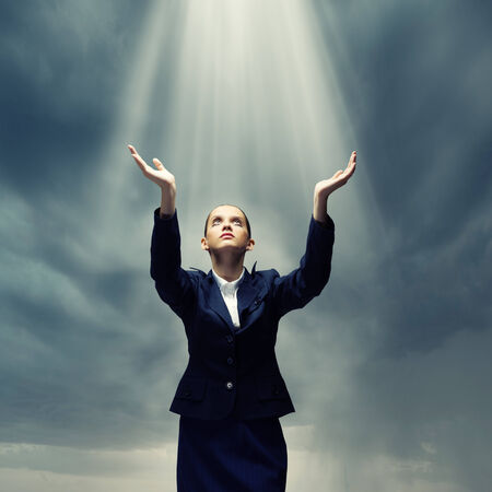 Young crying businesswoman with halo above head photo