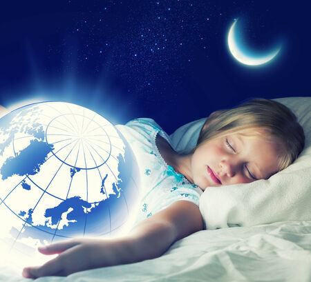 Girl in bed with Earth planet in hands photo