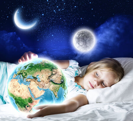 Girl in bed with Earth planet in hands  Elements of this image are furnished by NASA photo