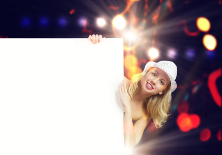 Nude girl standing behind white blank banner  Place for text photo