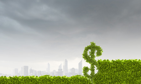 Conceptual image of green plant shaped like dollar symbol photo