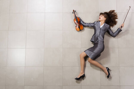 concerto: Funny image of running businesswoman with violin in hand