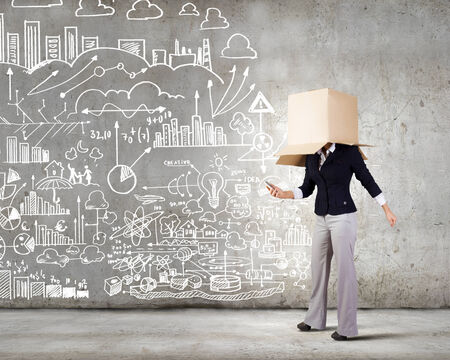 Conceptual image of businesswoman with carton box on head photo