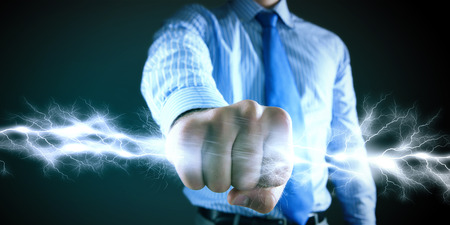 clenching: Close up image of businessman clenching fume in fist