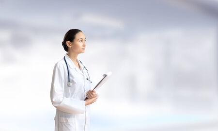 Young attractive woman doctor with stethoscope on neck Stock Photo - 25884241