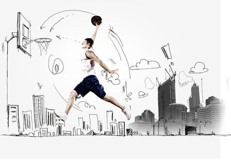 basketball net: Young man throwing ball into basket in jump Stock Photo