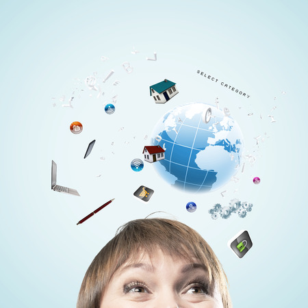 Half of face of businesswoman with business items above head photo