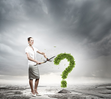 health answers: Conceptual image of green plant shaped like question mark