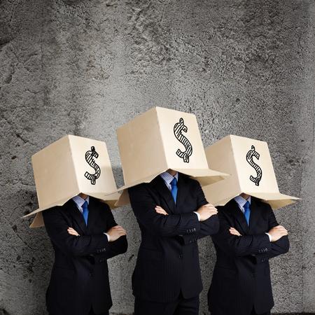 boxy: Businessman wearing carton box with dollar sign on head Stock Photo