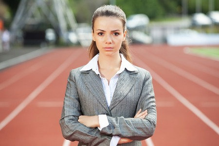 Businesswoman sport manager and executive at athletic stadium and race track Stock Photo - 25975847