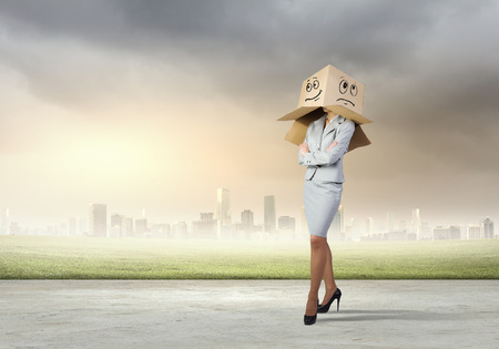 masquerader: Businesswoman in suit wearing carton box on head