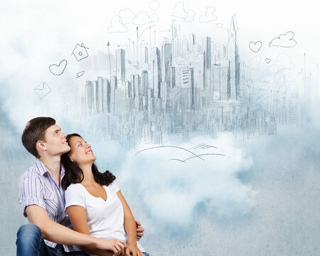 dating strategy: Young couple hugging each other and dreaming about future