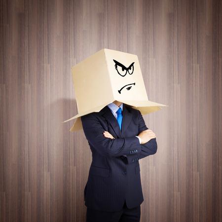 shyness: Businessman wearing carton box with smileys on head