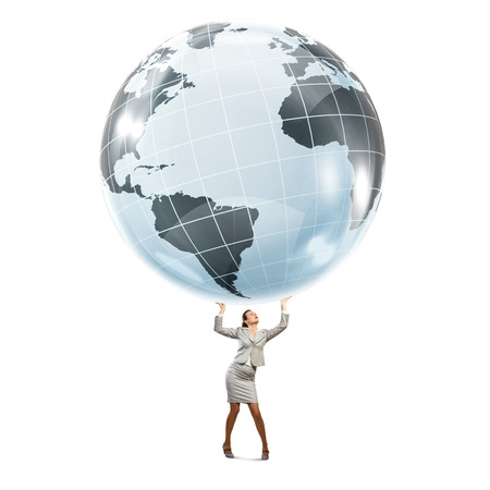lifting globe: Young businesswoman lifting digital globe above head Stock Photo