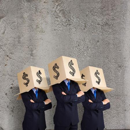 masquerader: Businessman wearing carton box with dollar sign on head Stock Photo