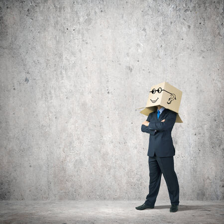Businessman with box on head showing different emotions photo
