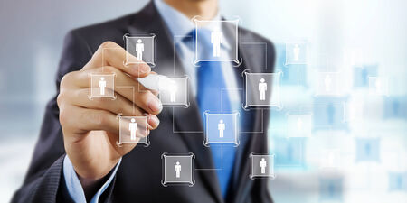net meeting: Close up of businessman drawing chain of interaction Stock Photo