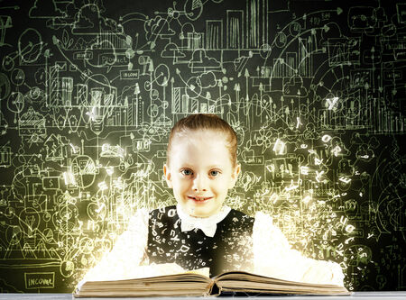 schoolkid search: Schoolgirl with opened book against sketch background Stock Photo