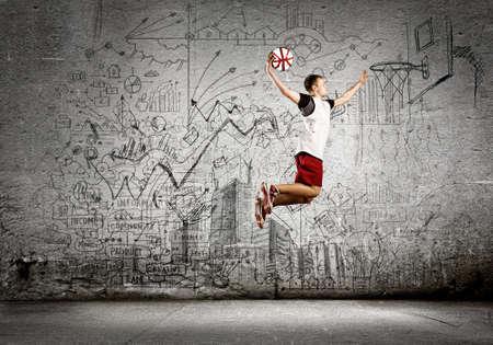 basket ball: Young man basketball player throwing ball in basket