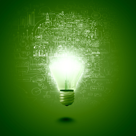 Conceptual image of electric bulb against green background Imagens