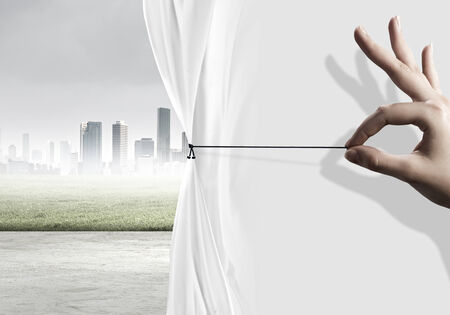 pollution free: Close up of hand opening the white curtain