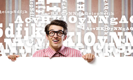 crazy man: Young man in casual holding white blank banner Stock Photo