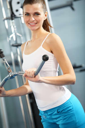 only the biceps: Image of fitness woman in gym working out