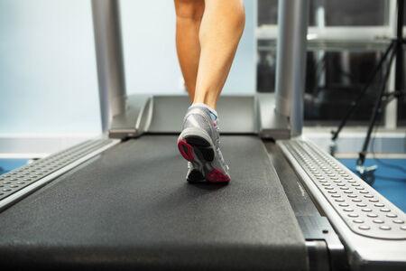 treadmill: Image of female foot running on treadmill Stock Photo