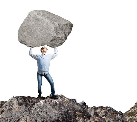 burdensome: Young strong man holding huge stone above head