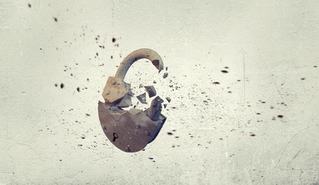 to break through: Conceptual image with stone broken lock on white background