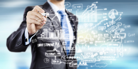 Close up of businessman drawing business strategy plan