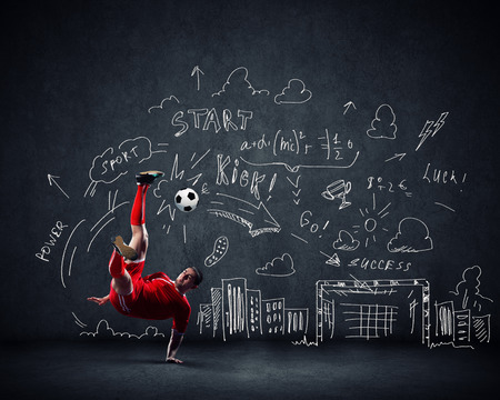 Football player in jump with sketches at background photo