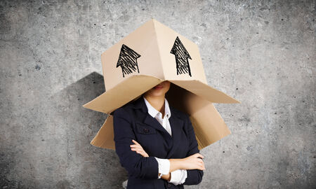masquerader: Businesswoman wearing carton box with drawings on head