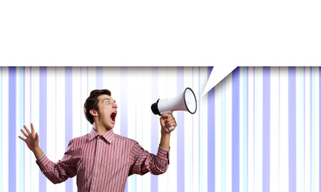 clenching: Young man in casual screaming in megaphone Stock Photo