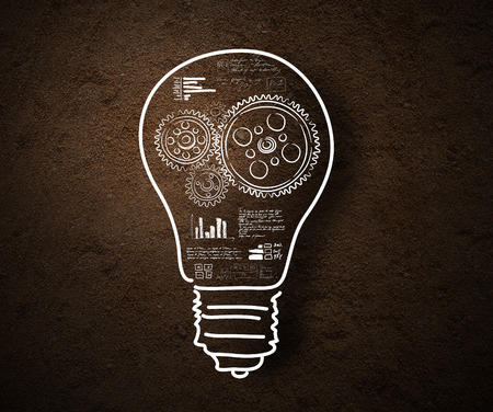 Conceptual image of light bulb and business strategy sketch photo