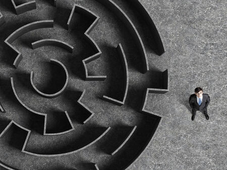 wayout: Top view of successful businessman standing near the entrance of labyrinth Stock Photo