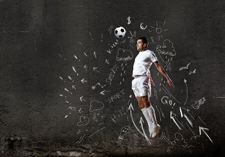 winning pitch: Football player in jump with sketches at background
