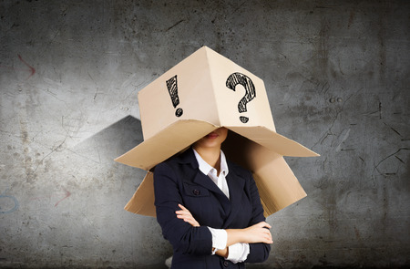 Businesswoman wearing carton box with marks on head photo