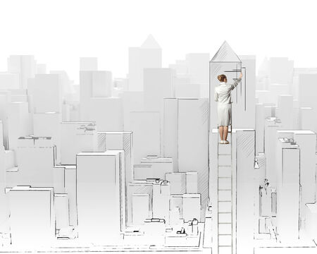 Businesswoman standing on ladder with back and drawing project of city photo